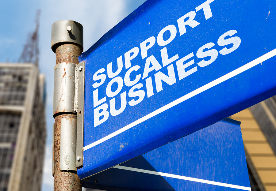 Support Local Business written on road sign-Vegas Ink and Toner