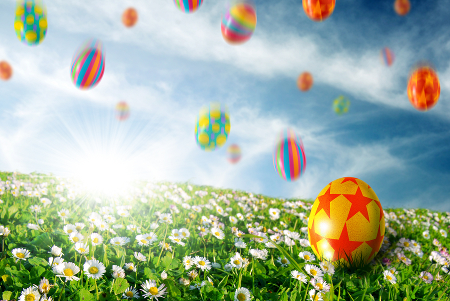 Colorful Easter eggs falling down on a flower field- Vegas Ink and Toner