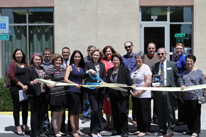 Cutting the ribbon at Vegas Ink and Toner re-grand opening