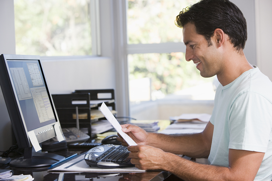 Man doing work on computer in home office - Vegas Ink and Toner
