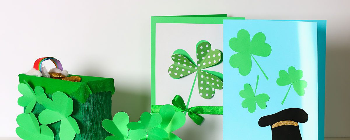 Homemade St. Patrick's Day cards and decorations against a white background