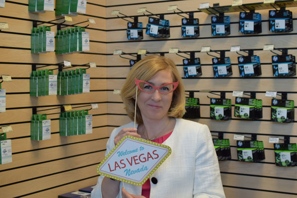 Yana holding up a Las Vegas sign and fake glasses