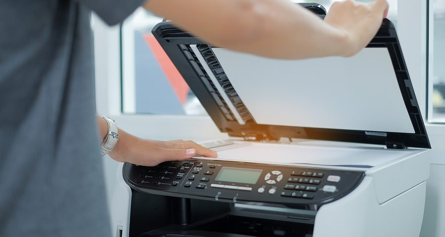 Bussiness Woman Hand Putting A Document Paper Into Printer Scann