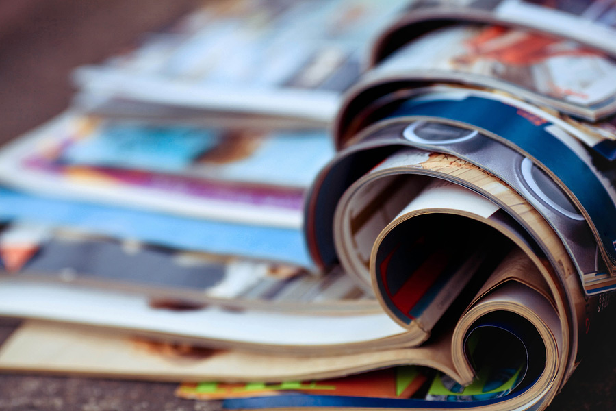 Close up of Stack of Colorful Print Magazine