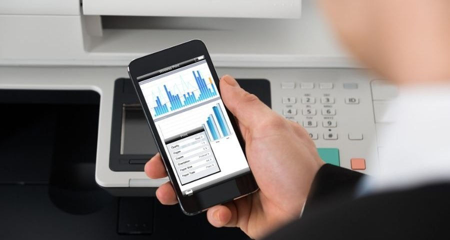 A man using an app on his phone to print a document presentation