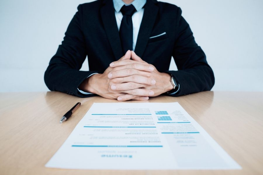 A man with his resume on the table