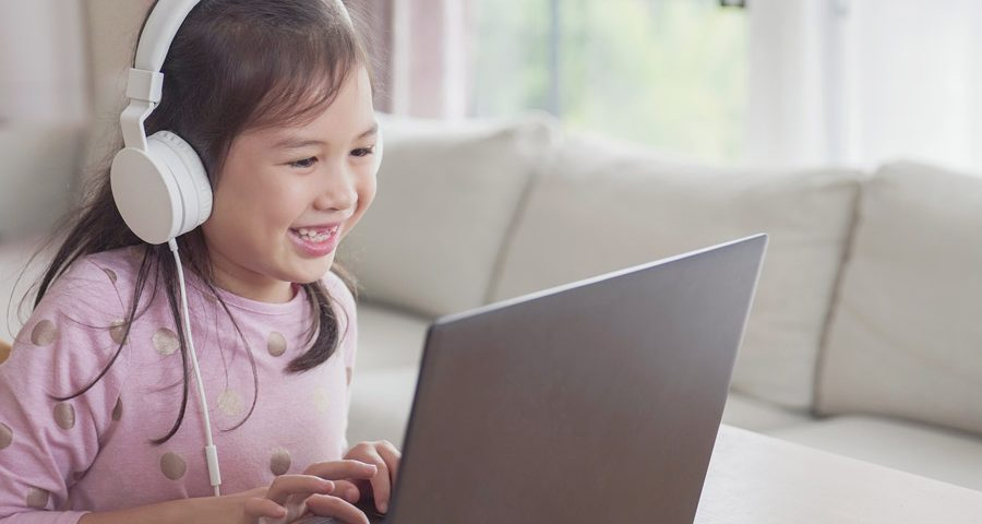 Girl learning online on a laptop