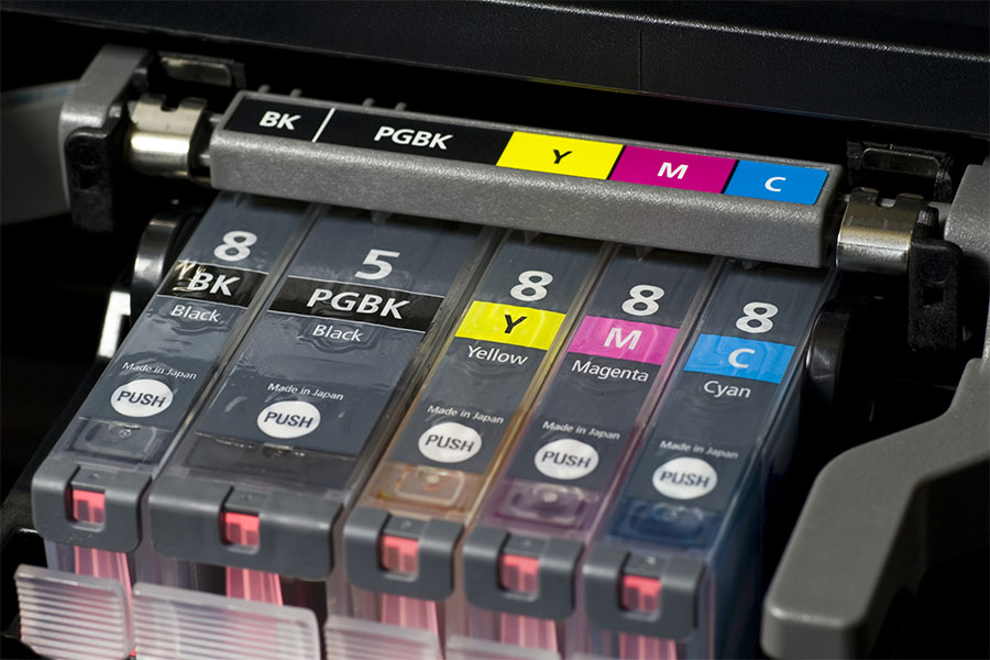 close-up shot of a CMYK ink cartridges for a color printer