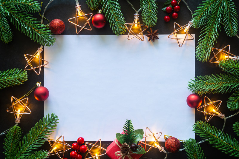 An envelope with a Christmas tree card inside it