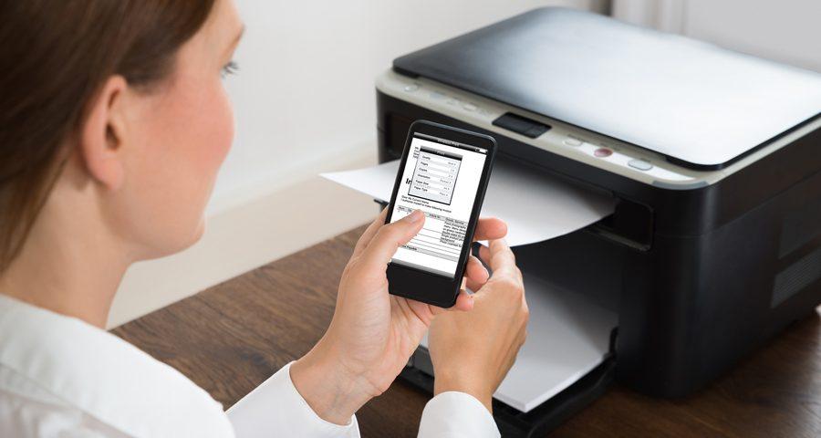 A woman using a wireless printer