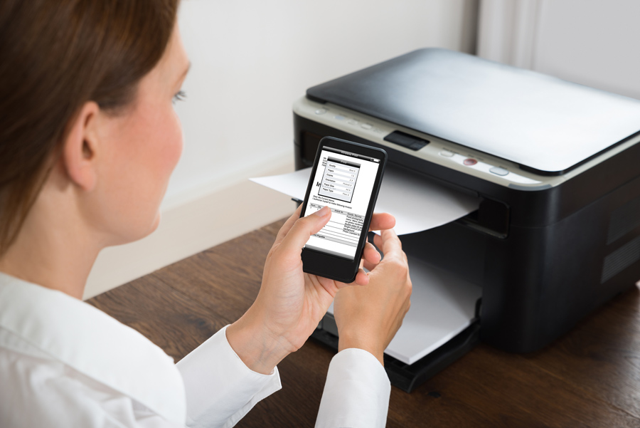 A woman using a wireless printer