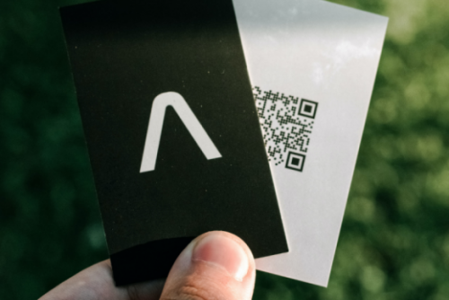Holding two business cards
